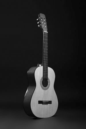isolated acoustic guitar on dark background