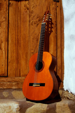 spanish acoustic guitar on an old doorstep in spain